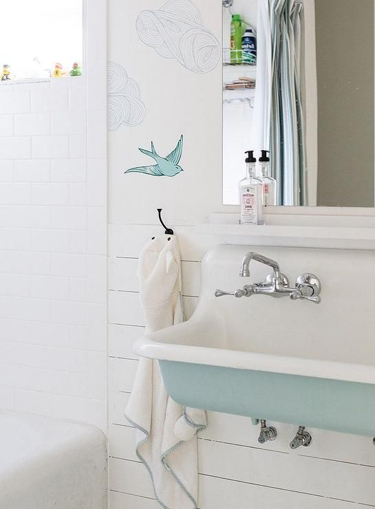Oh this is a great shot, I just wish they had taken down their shower caddy rack because all I see is Barbasol shaving cream and garnier fructis shampoo instead of the  Hygge and West's Daydream wallpaper . But this is still a great bathroom.
