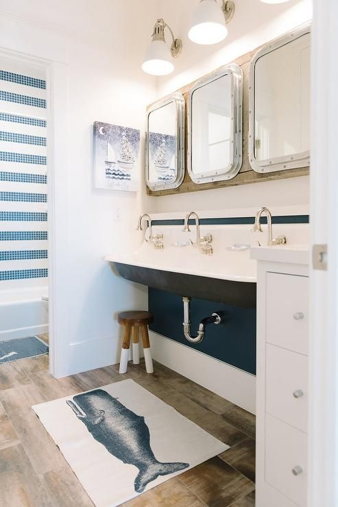 This is not subtle nautical, but I do really like it. And those mirrors!!!