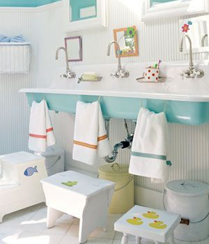 Oh my goodness!  Again, could you imagine 3 little ones standing here?  They even have low mirrors for them!  I'm going to have to stop looking at these it's giving me baby fever!