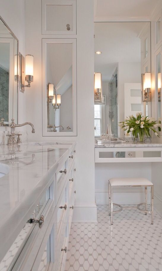 Mirrors are such a great way to bounce light and make a room feel bigger.  add those to an all white room and you'll feel like you're in a 1,000 sq. ft. bathroom.