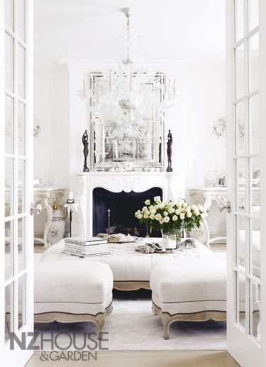 This  room  is very parisian minus all the ornate trim details and herringbone floor.  But is an inviting, feminine space.