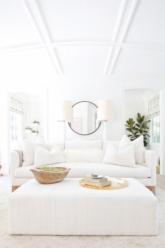 This room is very california.  It's a true, all white room but with the small touches of wood it warms the space up.  It also doesn't hurt when you have a coffered arched ceiling either.  via  jenni kayne