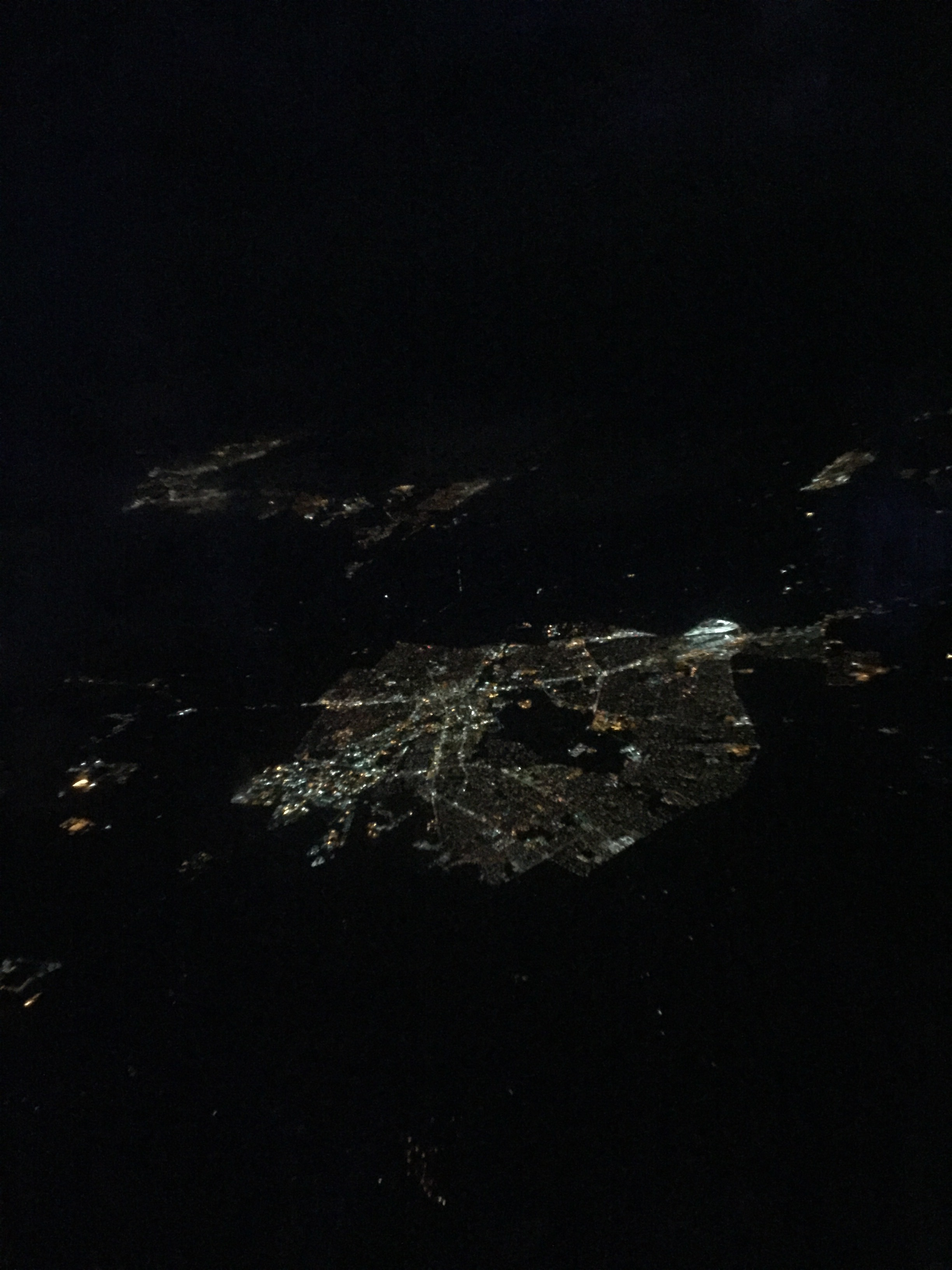 View from the plane. Isn't it crazy to see big cities like this? To see thousands of homes as tiny dots of light that can fit in the size of your palm.