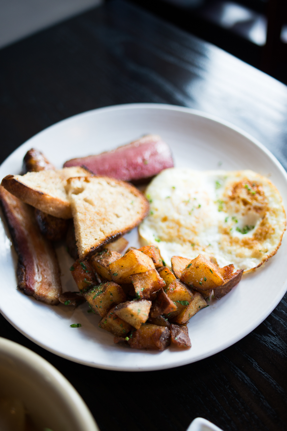 H&R Breakfast - Eggs, Merguez Sausage, Wagyu Pastrami, Bacon, Home Fries, Toast