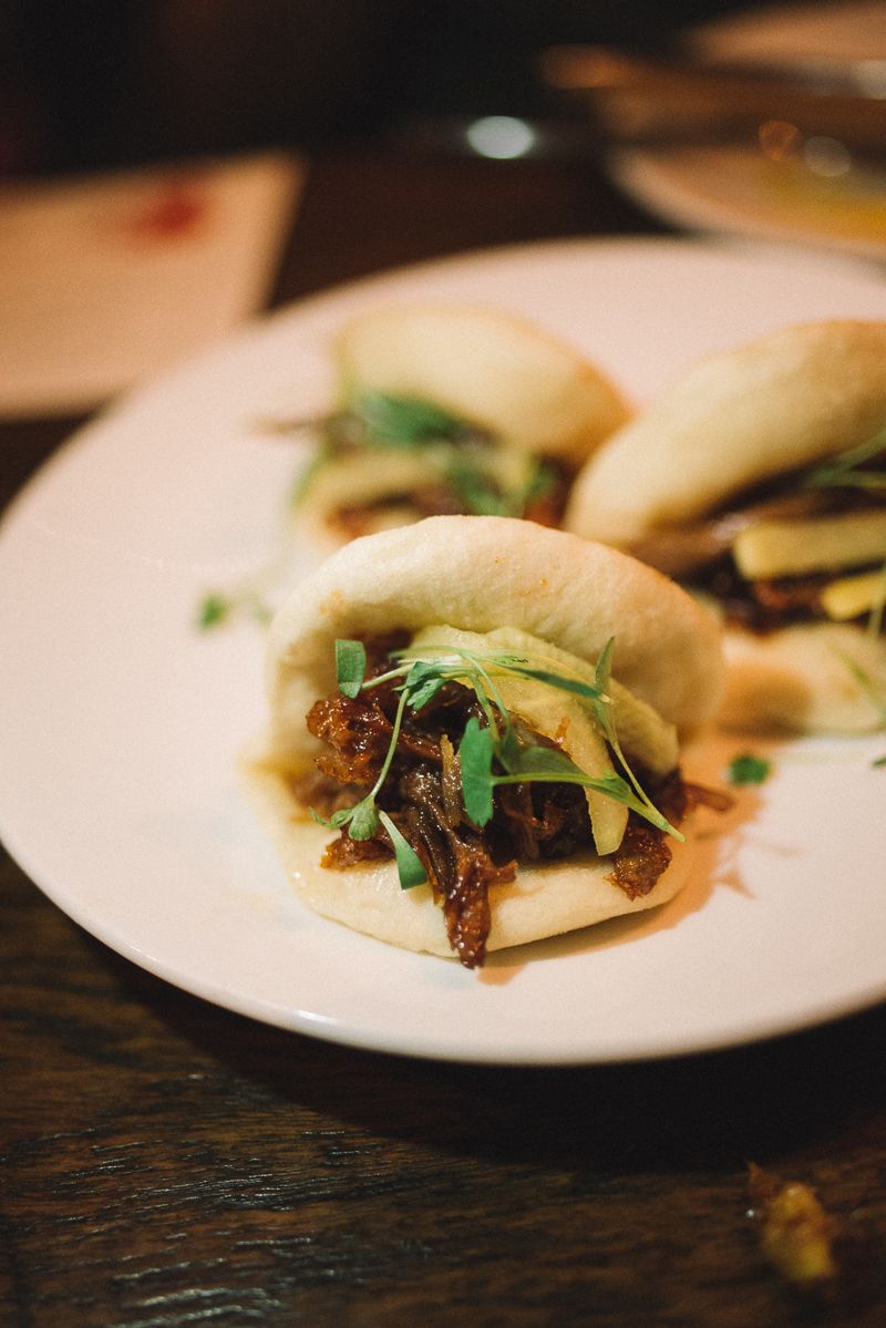 STEAMED BUNS | char siu duck confit, pickled daikon, sprouts