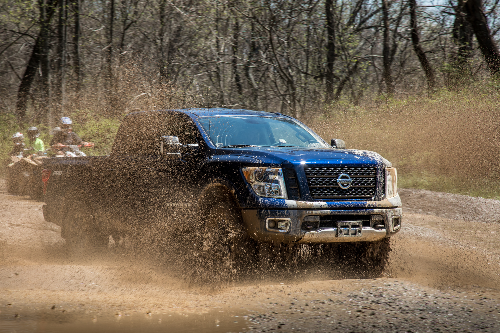 33-nissan-titan-2018-angle--blue--dynamic--exterior--front--off-road.jpg