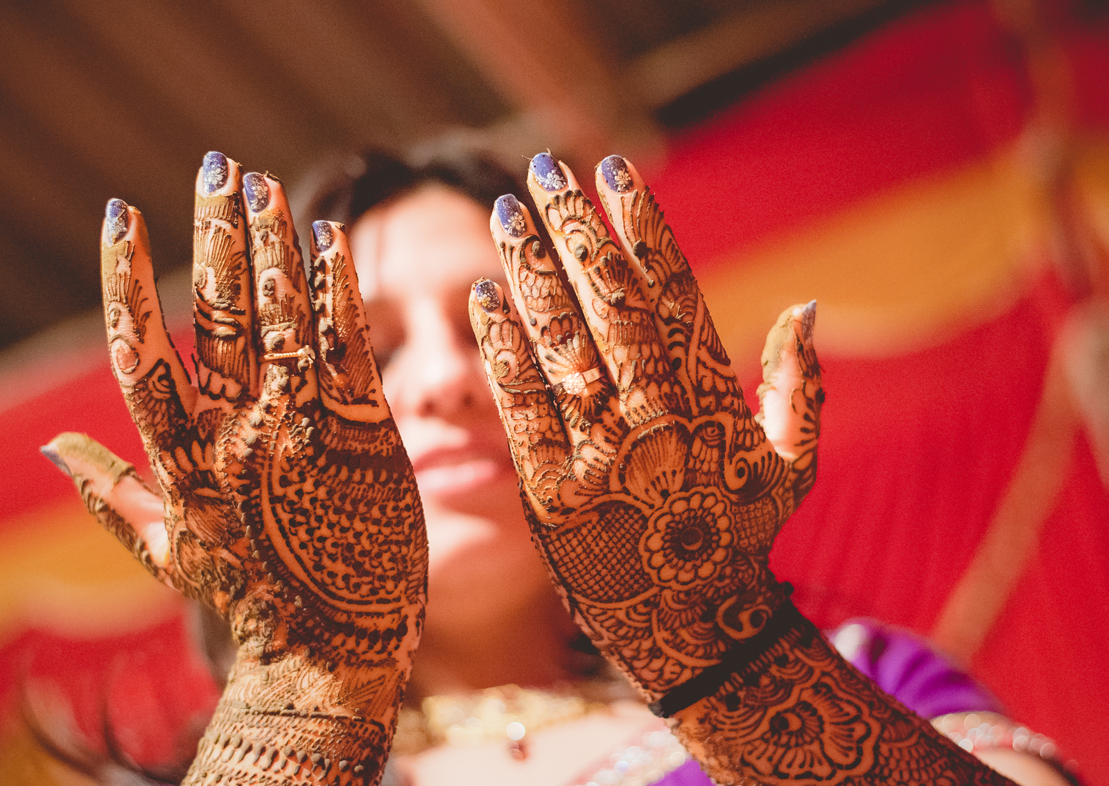 Henna tattoo on the hands on Indian bride