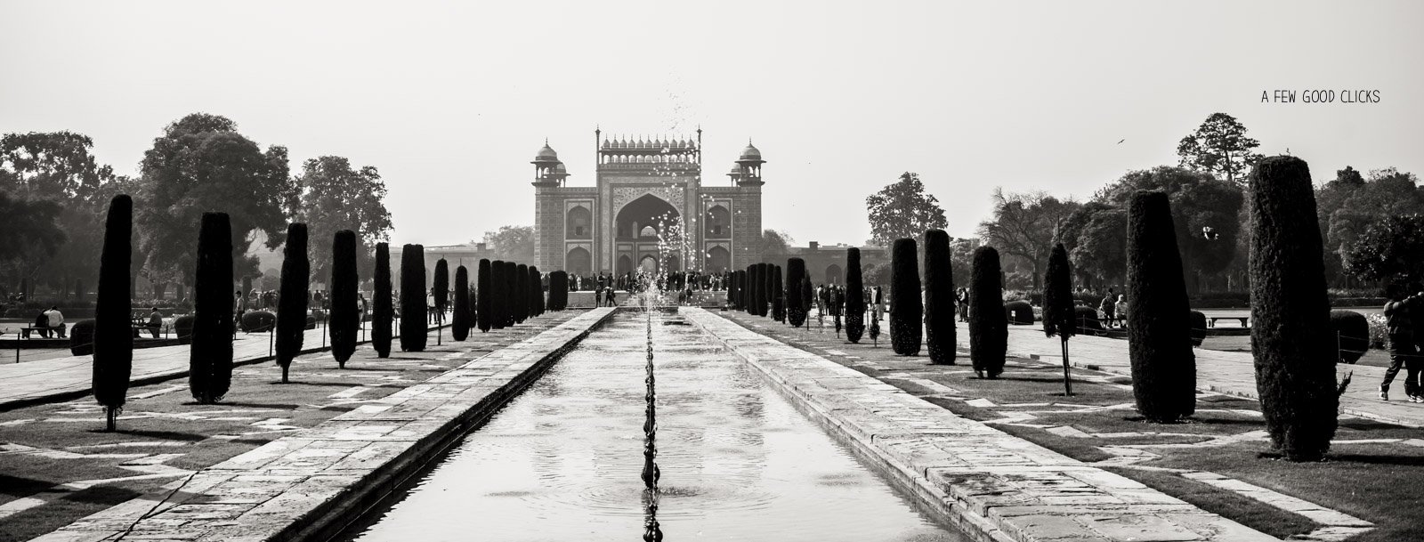 In this image, I am standing right in front of Taj facing the main entrance and fountains