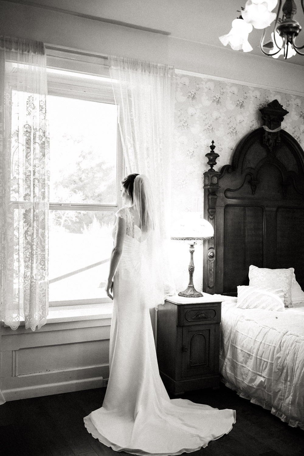 Photo of the bride at the window in black and white is simply timeless and elegant.