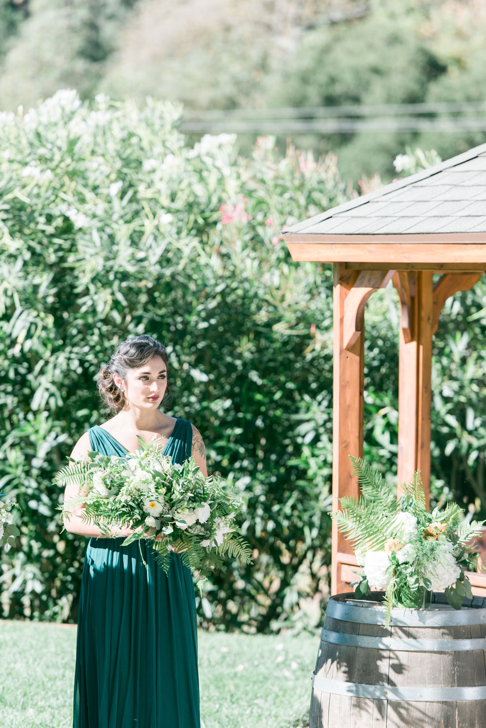 Bridesmaid waiting for the bride at the altar |  Elliston Winery Wedding Photos