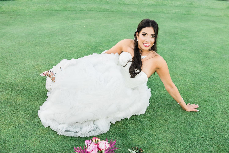 Gorgeous bride having fun during the wedding photoshoot