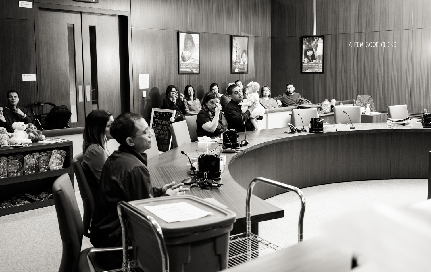 The scene inside the courtroom while the judge process the legal formalities
