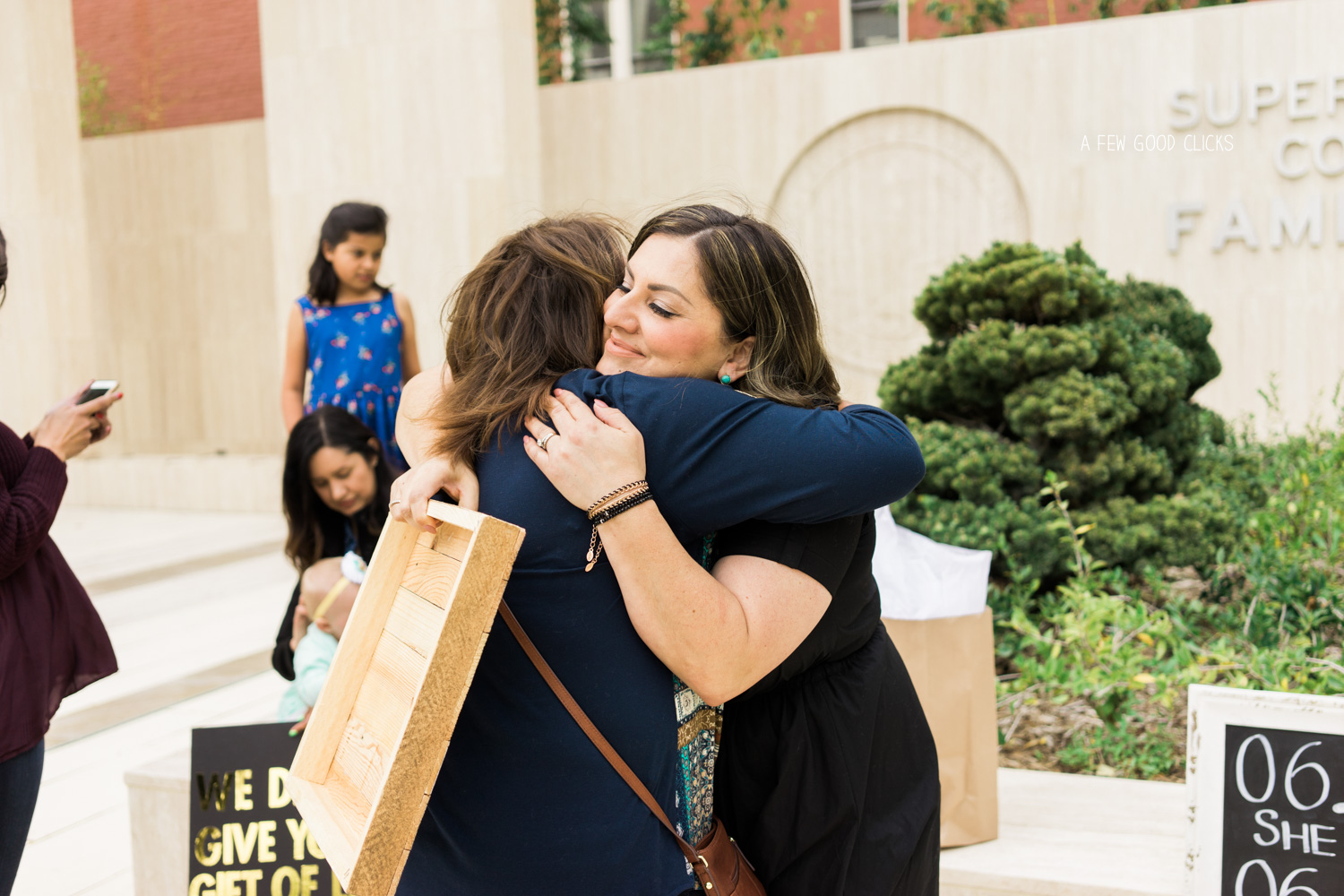 Moments of hugging & crying right after the ceremony outside the courthouse.
