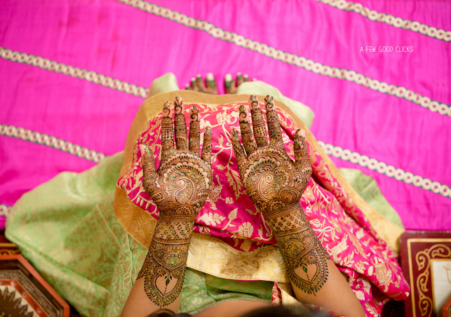 Indian Bride with beautiful mehndi design on palms.