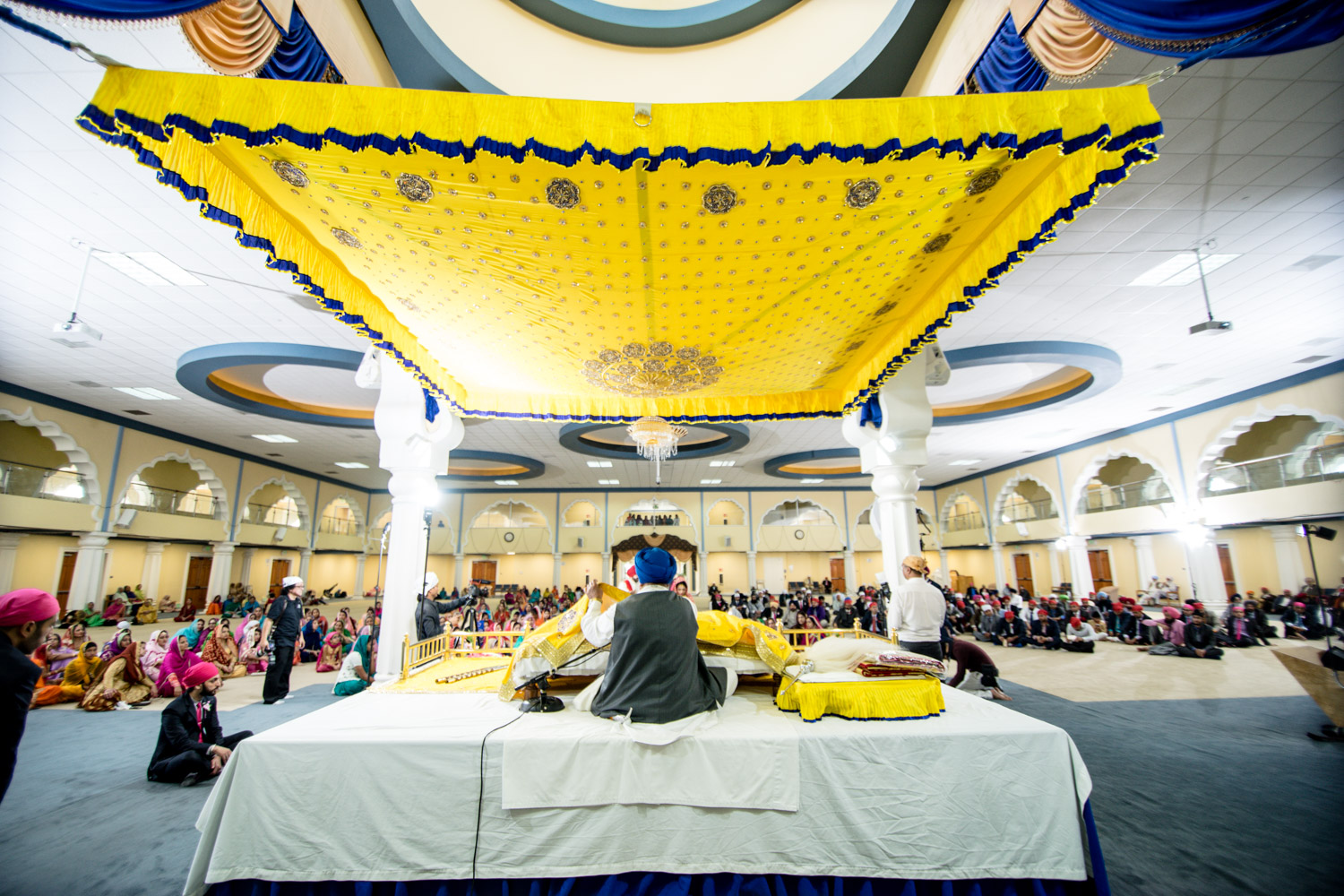 The wide angle shot of the holy book and the gurudwara.