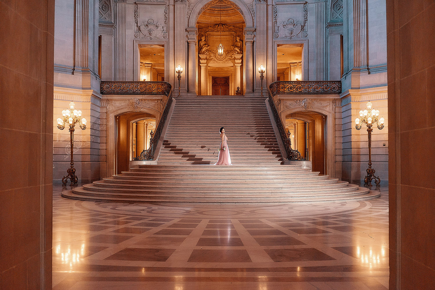 Bride walking down the grand staircase at City hall
