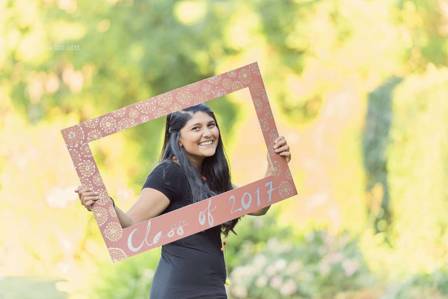 Solo portraits with Class of 2017 board