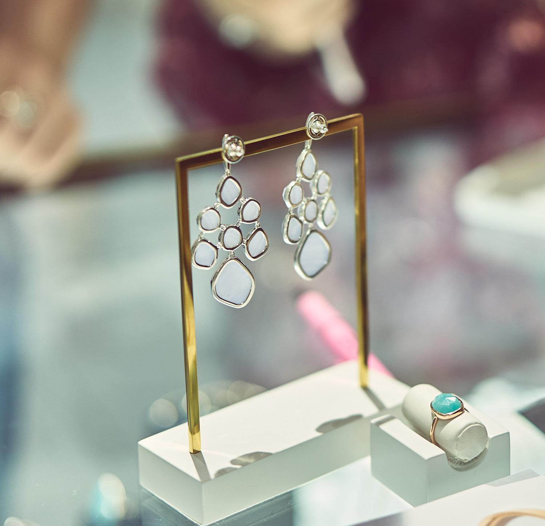 Monica's signature earrings on display.