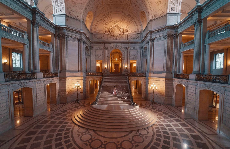Bride walking at San Francisco's City Hall Grand Staircase