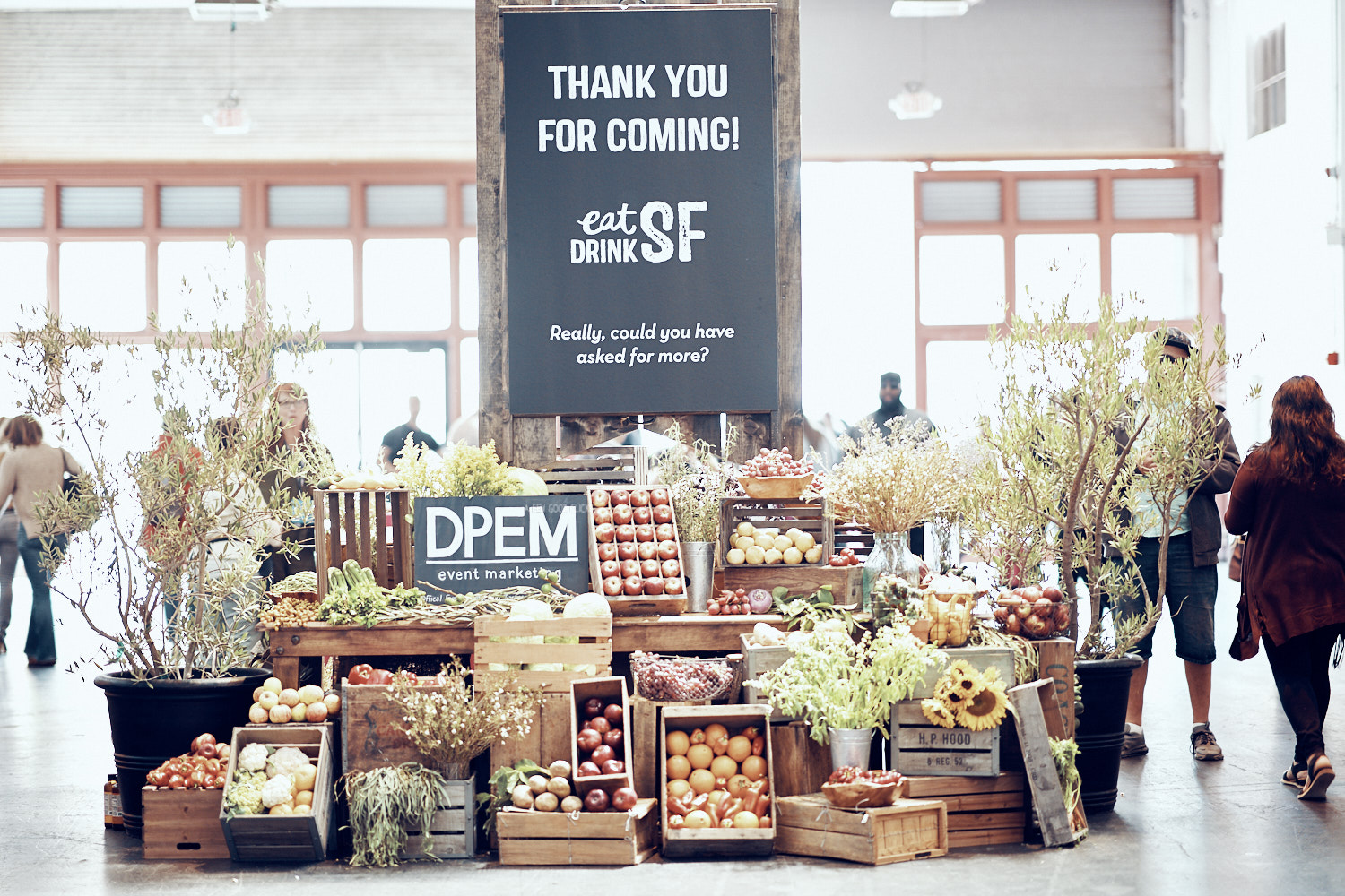 Thank you for coming Sign at Eat Drink SF with an array of veggies on display.
