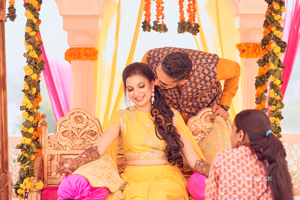 groom-kissing-bride-surprise-mehndi-event-photographer-bay-area