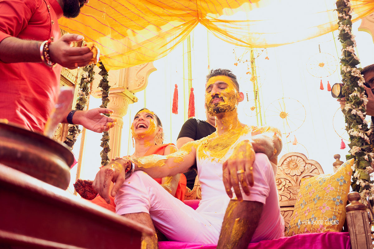 Fun with haldi | Bride and groom playing haldi with everyone in the party.