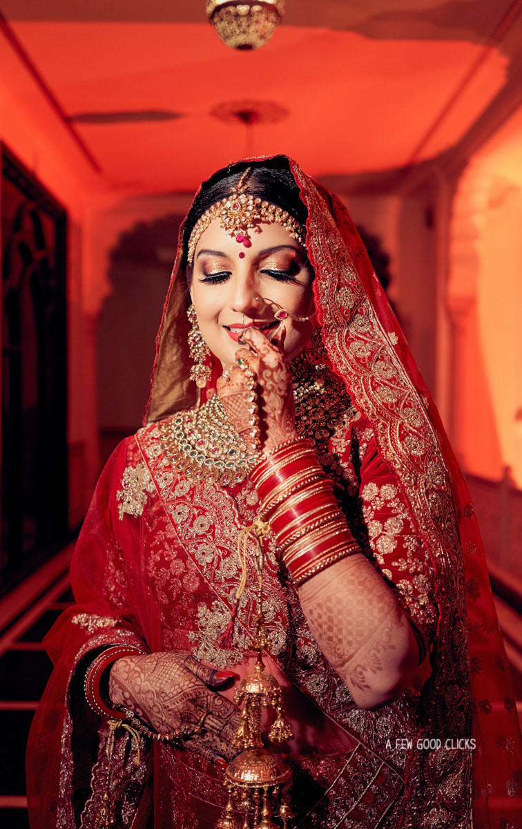 rajput-bridal-holding-nosering-photos-in-indian-weddings-jaipur