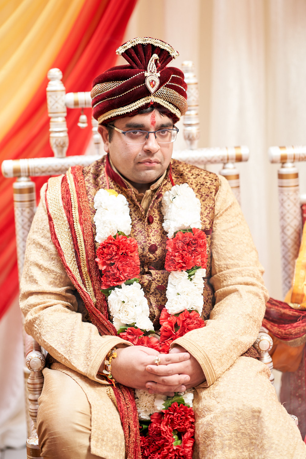Groom sitting at the mandap in Sunnyvale temple.
