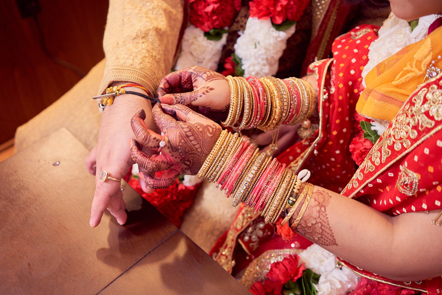 Open the gaana ( the holy thread). Brides generally get a pass by using both hands whereas groom is allowed to use only one hand..:)
