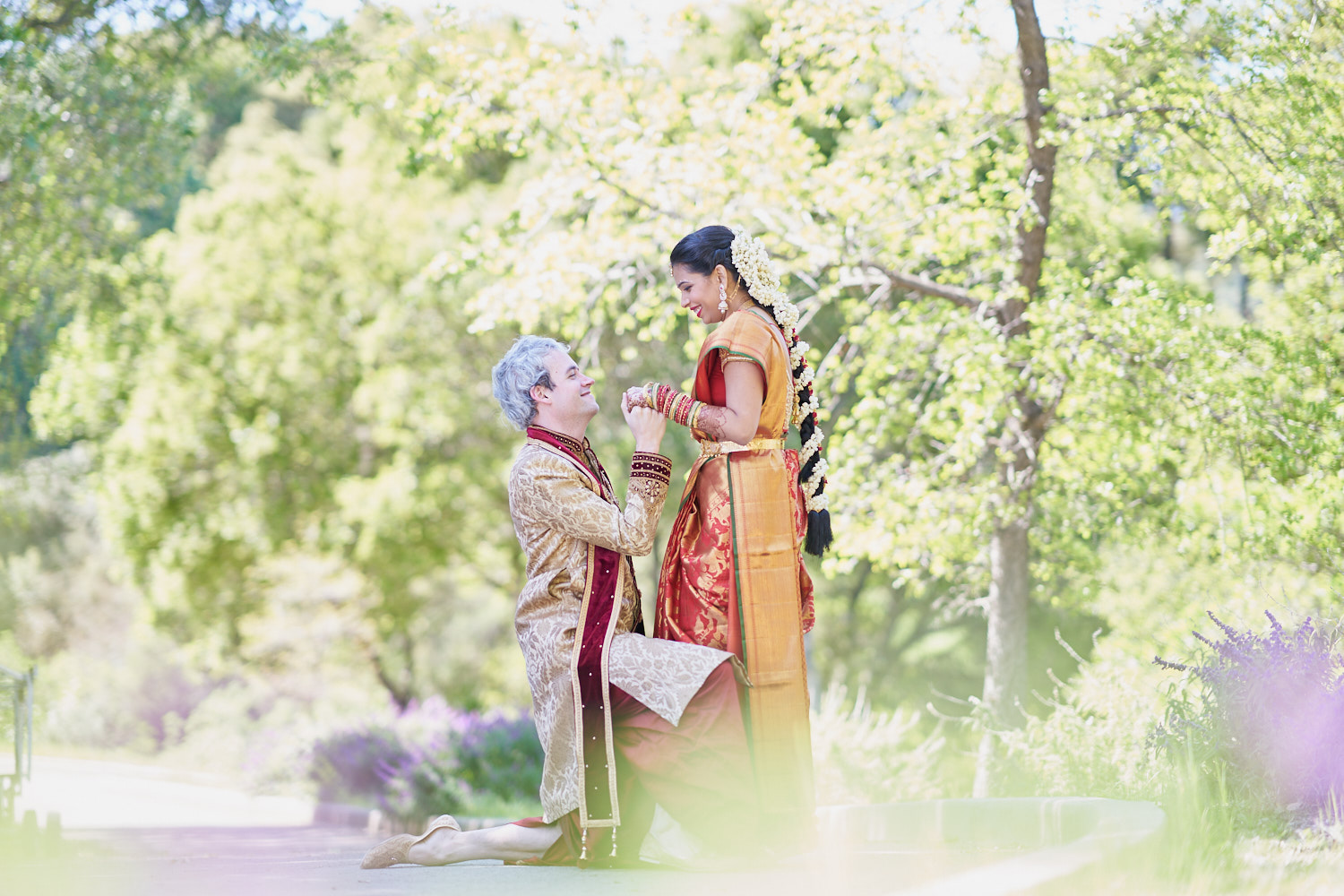 Couple Goals - Groom kneeling down in front of his bride is still in fashion and super cute. Don't you agree?
