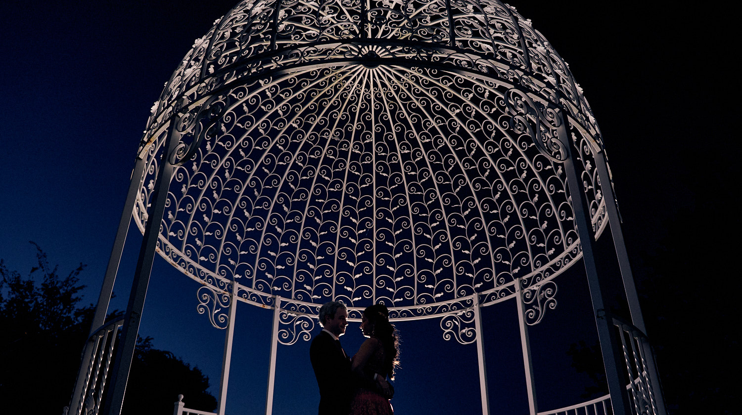 Silhouettes of the couple under the gazeebo at Saratoga Country Club.