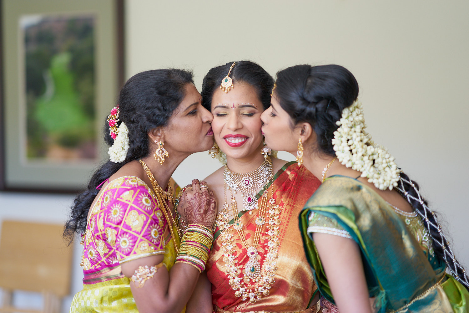 Mother & sister kissing.