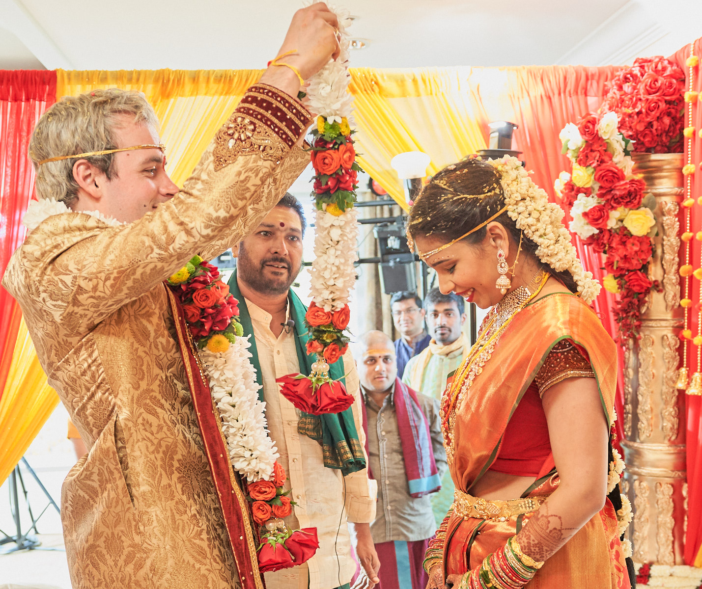 Mixed race couple exchanging garlands - at least this is common with north Indian style wedding.