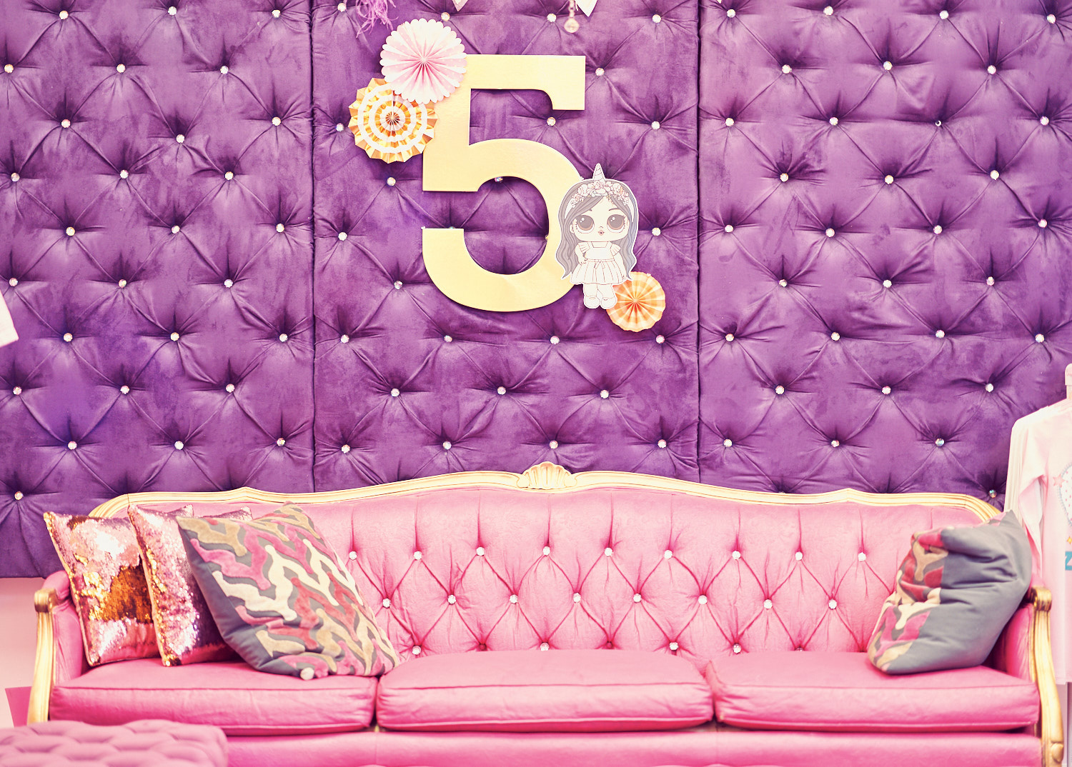 Glam is the way to go - Pink couch with purple headboard provides a perfect backdrop for your little diva.