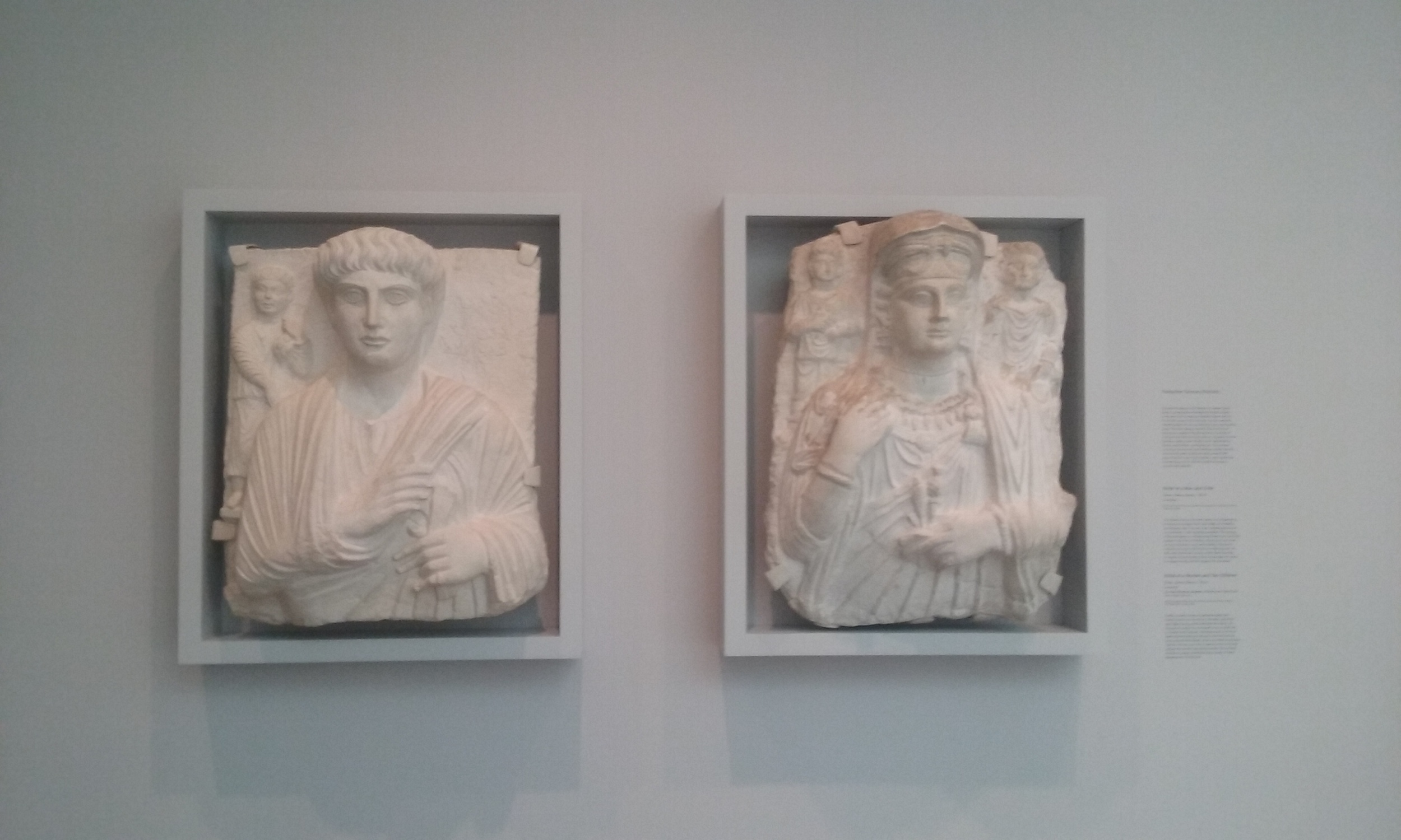 Relief of a Man and Child (1998.3) and Relief of a Woman and Two Children (1906.3) from Palmyra, c. 150 CE. (Fogg Museum, Harvard University)