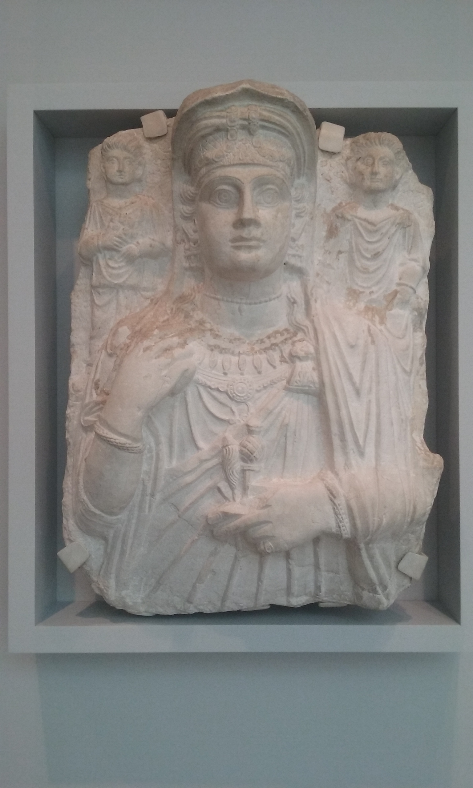 Relief of a Woman and Two Children. The two children are holding symbols of their family's agricultural wealth