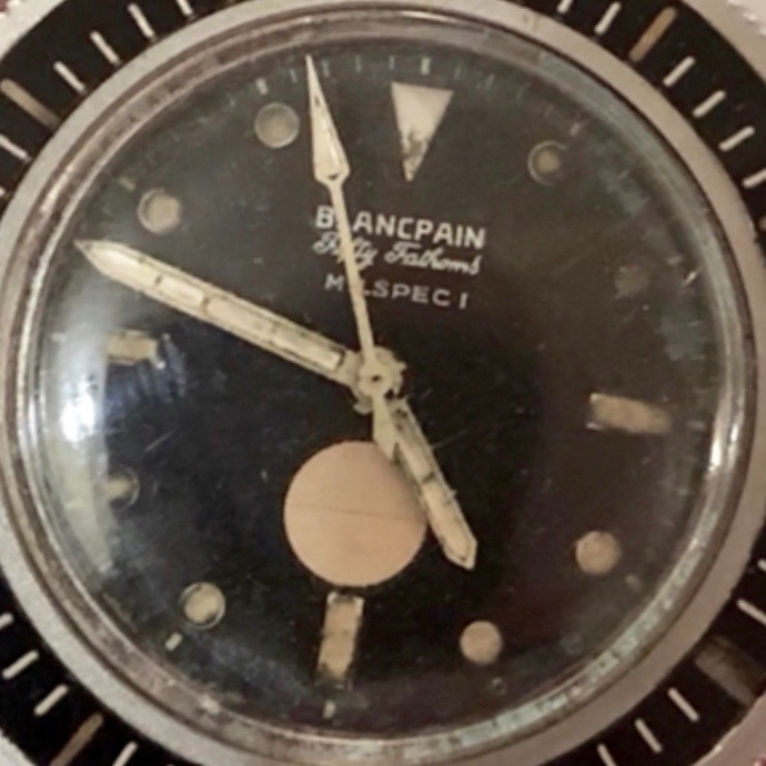 """Blancpain Fifty Fathoms diving watch specially engraved """"AM"""" - The Blancpain watch company, along with Rolex, was one of the great pioneers of the underwater watch. The Fifty Fathoms model was designed in collaboration with undersea explorer Jacques Cousteau. Initially produced in 1953, it became the preferred watch for professional and military divers throughout the 1950s and early 1960s. This specially prepared """"AM"""" – fpr """"anti-magnetic""""or """"amagnetic"""" – model was designed for use by underwater EOD (explosive ordnance disposal) divers. Since many underwater explosive devices contain magnetic fuses, most of the ferrous components of this timepiece were replaced by copper-beryllium parts to minimize the watch's magnetic signature. The watch case is made entirely of amagnetic mu-metal."""