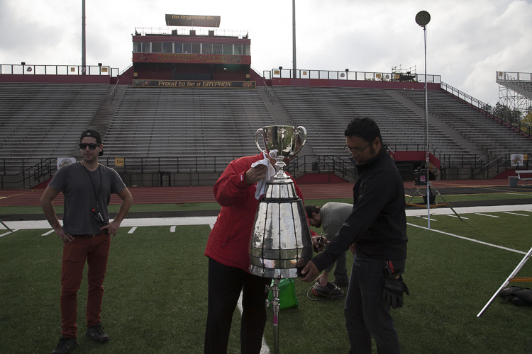 The Cup caretaker carefully places the trophy onto the rig.