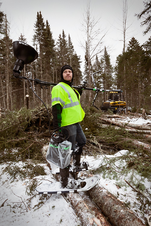 Aaron Hoskins sporting snowshoes while traipsing through the forest with our battery lighting kit.