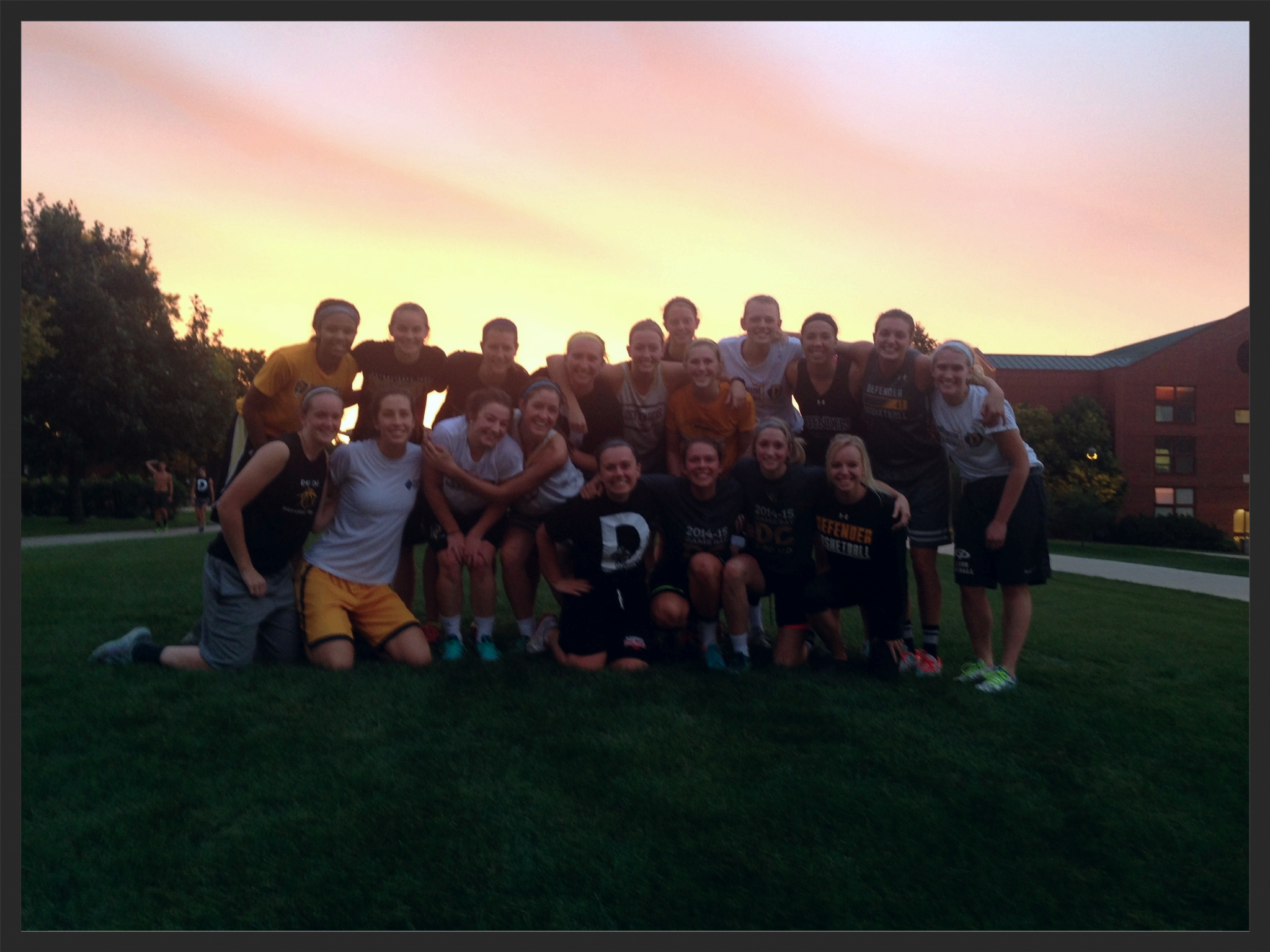 The Dordt Women's Basketball team after a 6am preseason workout. We decided we had to capture the beautiful sunset God blessed us with and pure relief of being done with our morning workout. :)