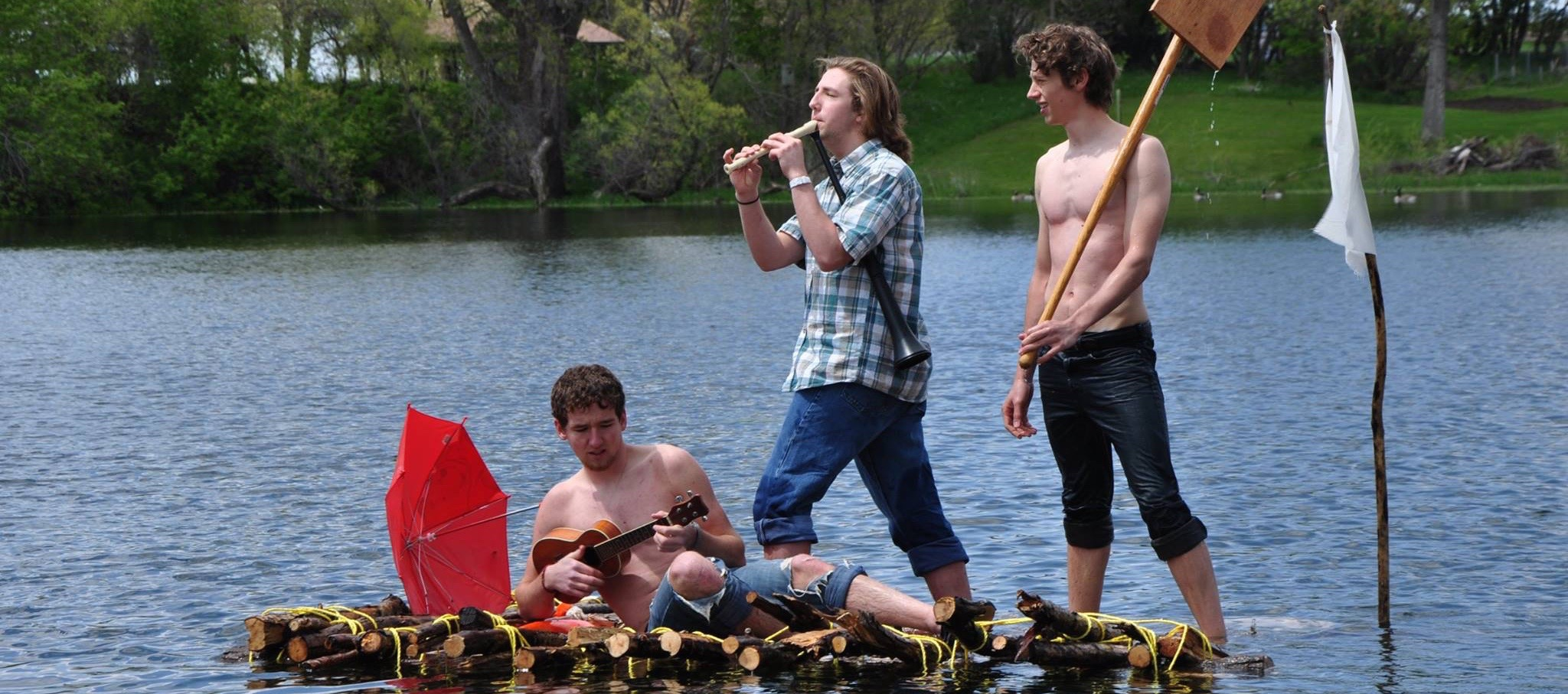 """Freshman students Seth Weirup, Daniel Seaman, and Levi Smith improvise Tom Sawyer Tuesday's themesong while floating down the """"MississippI."""""""