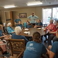 Students and leaders playing games at the nursing home.