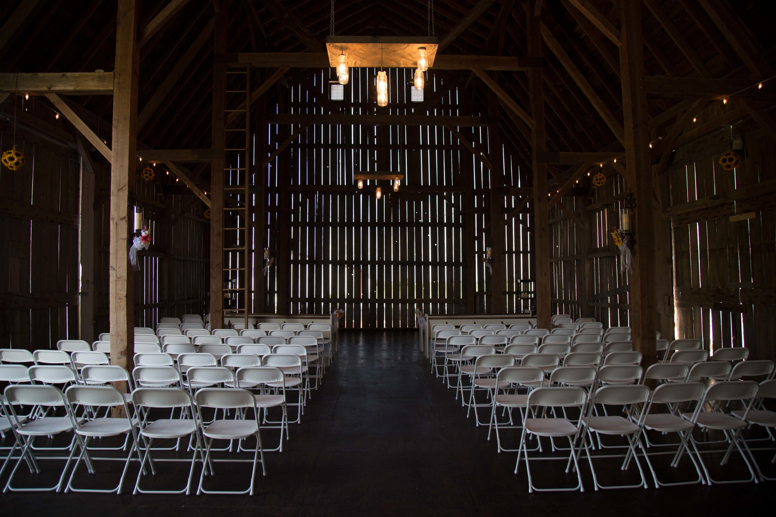 6_27-barn_white_chair_Ceremony_6158 2.jpg