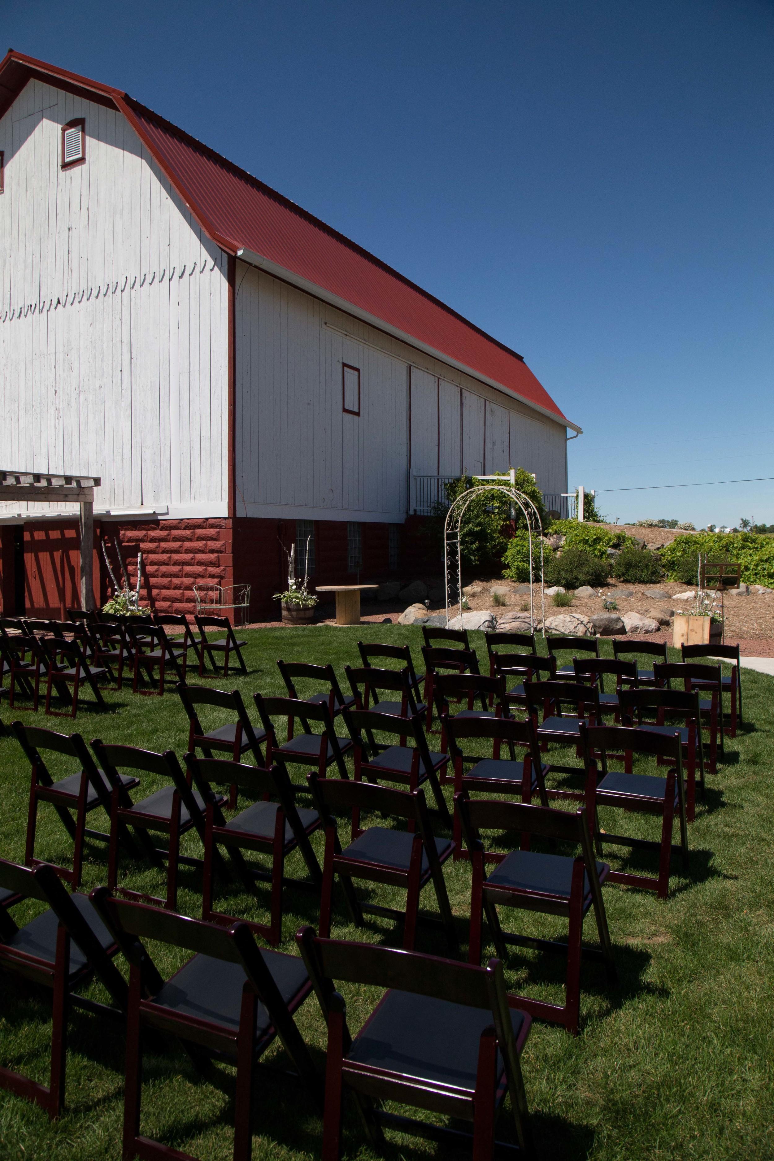 6_19-Courtyard_Ceremony_Mahogany_chairs_5697 2.jpg