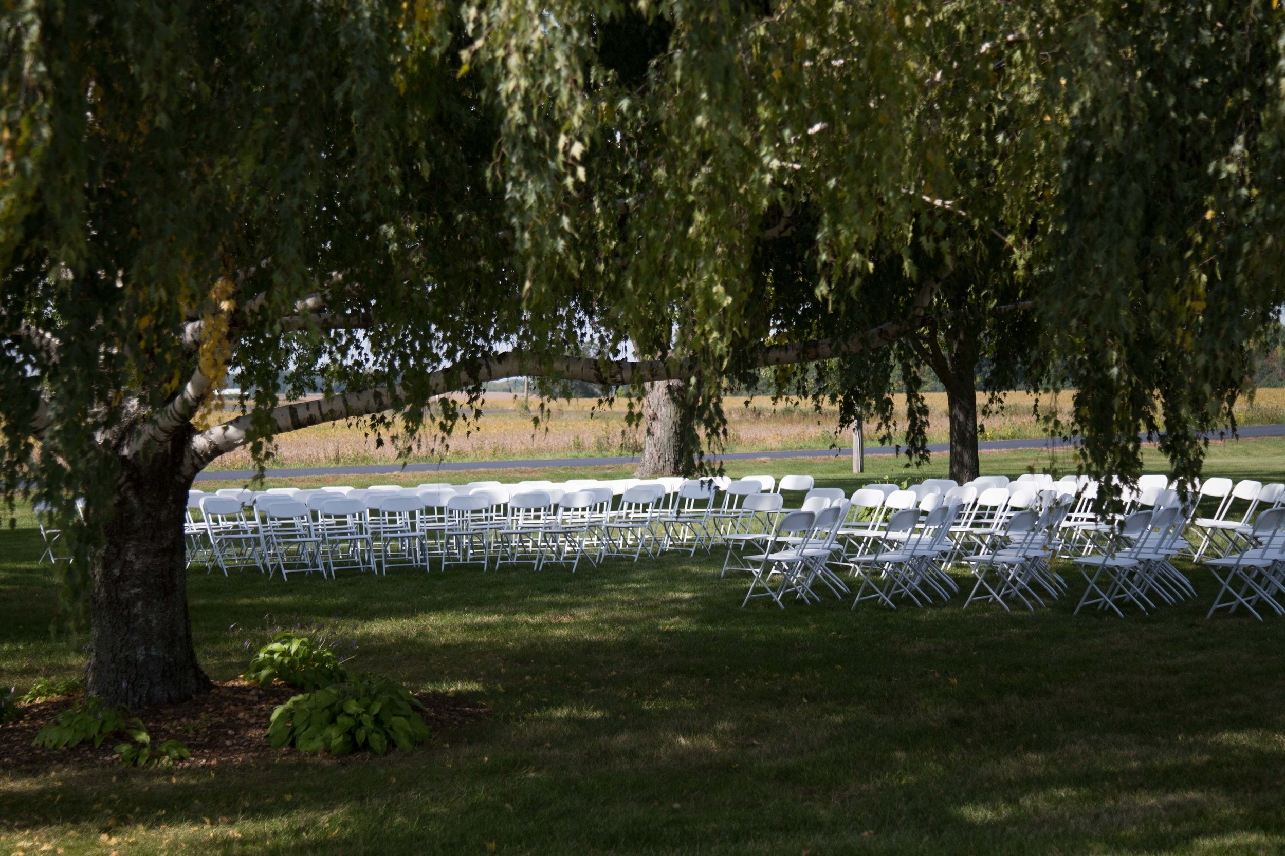 9_25-Birches_ceremony_white_chairs_8424.jpg