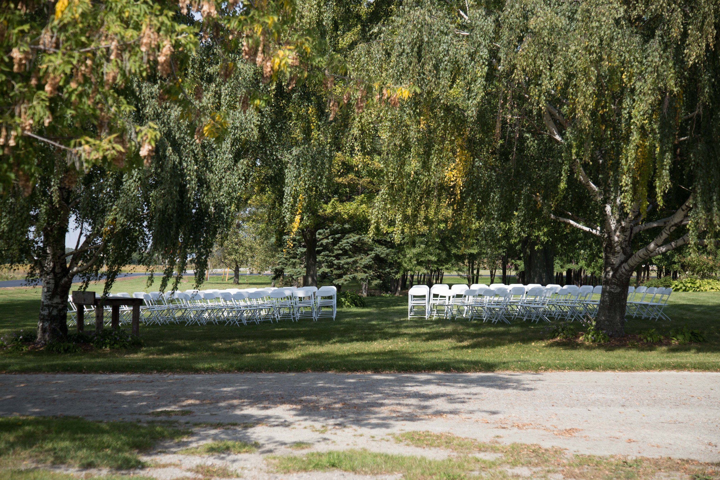 9_25-Birches_Ceremony_White_chairs_8357.jpg