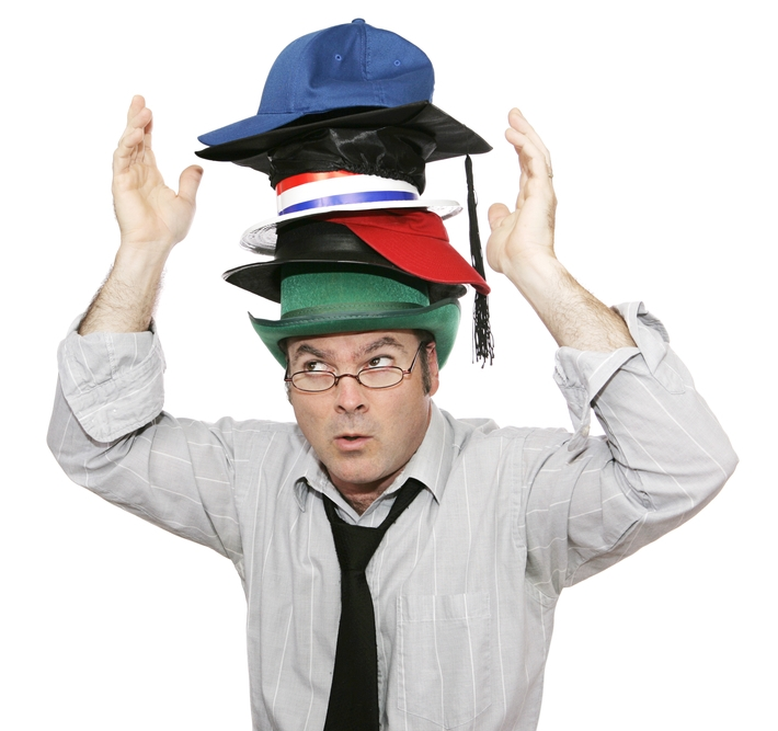 small business owner wearing many hats