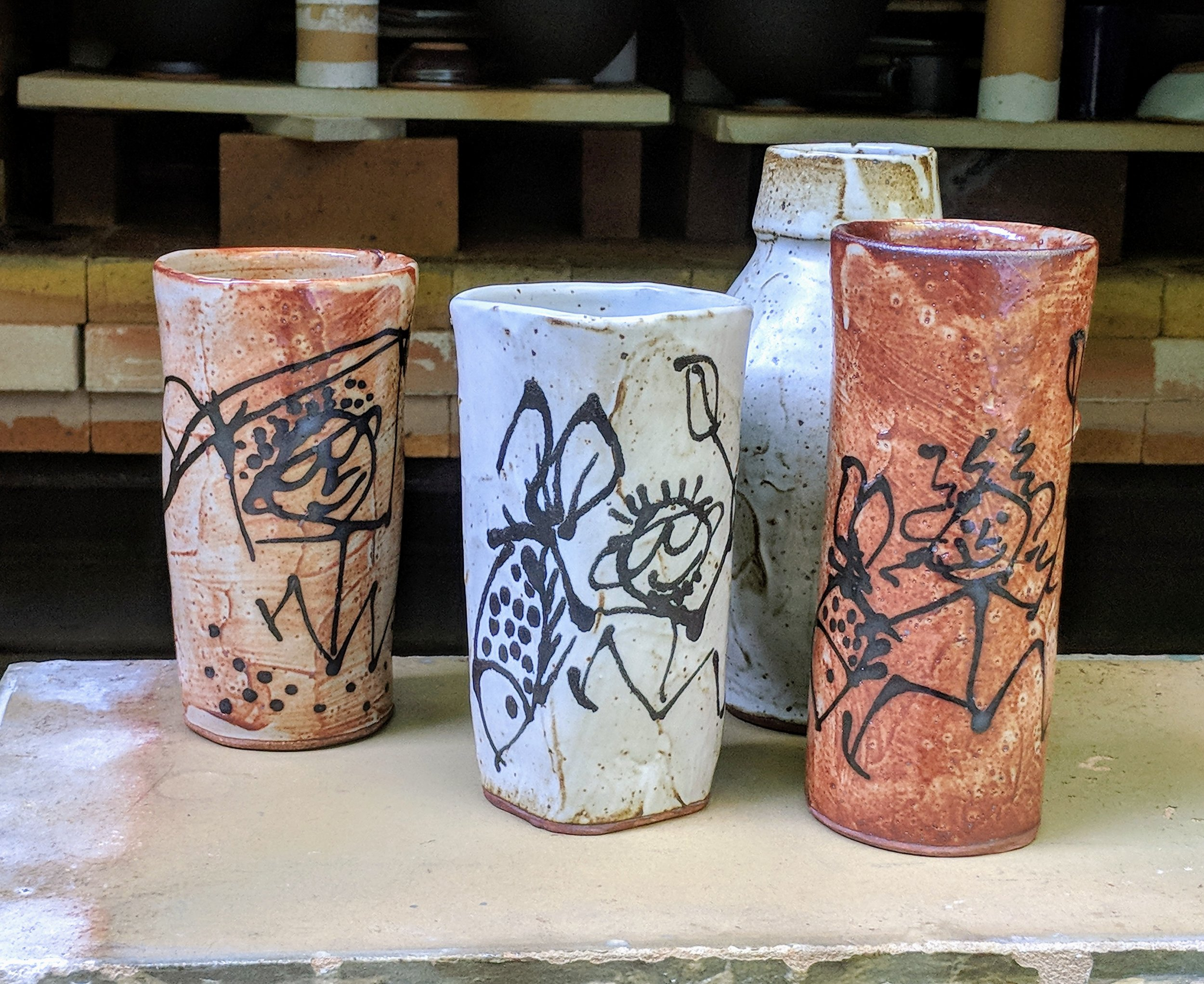 whimsical pots made with Darkstar wild clay