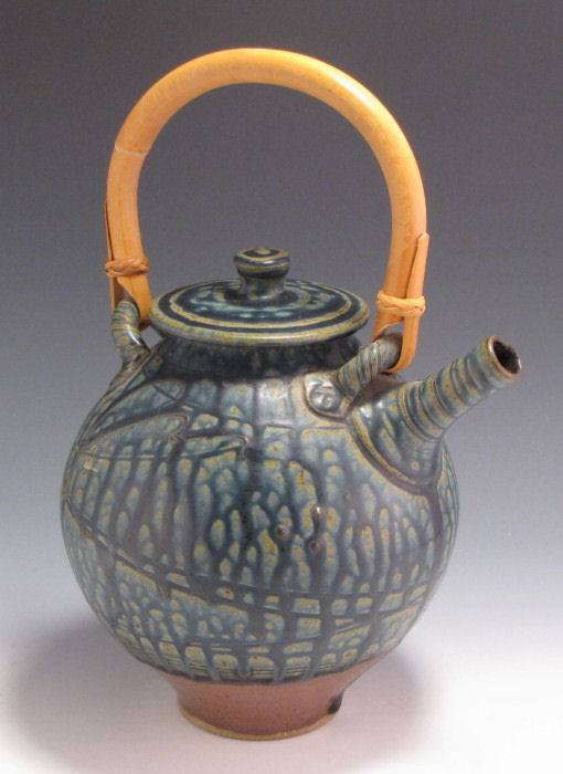teapots in iron red and blue ash glaze with slip-trailed dragonfly.