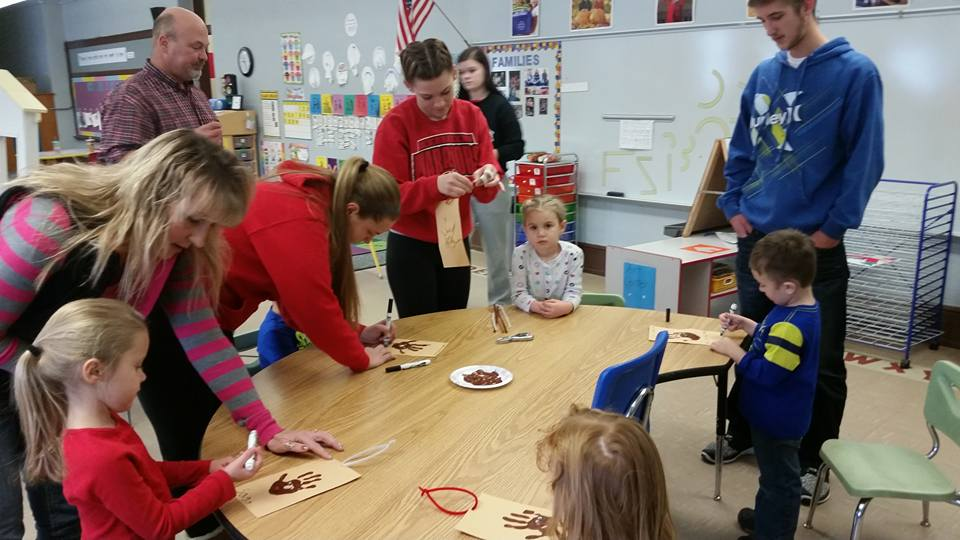 "Preschool students making hands to promote ""Then Feed Just One"""
